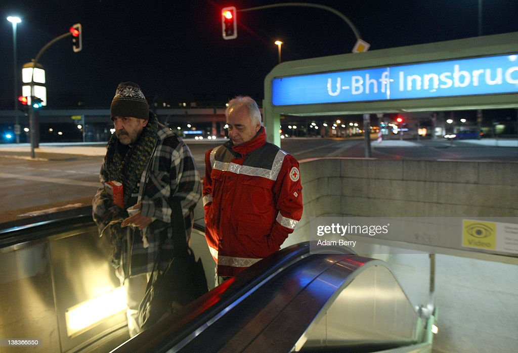 German Red Cross volunteer employee Carlo Trobisch (R) walks with a homeless man by the name of Rainer as they head to the Waermebus, or Warmth Van, to travel to a homeless shelter on February 6, 2012 in Berlin, Germany. The Waermebus, a program ran by the German Red Cross, assists the homeless in times of extremely low temperatures with blankets, food, clothing and finding lodging. Nearly 300 people across Europe have died during the current cold wave, a majority of whom were without shelter.