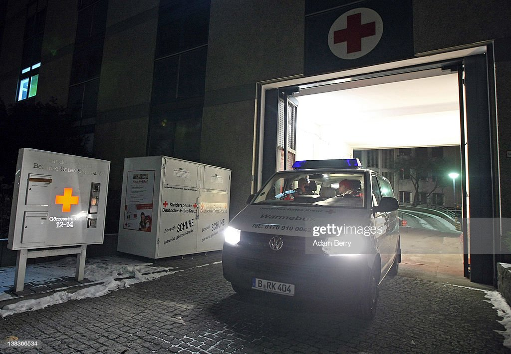 German Red Cross volunteers Adel Far (R) and Carlo Trobisch leave a Red Cross building to make the rounds in the Waermebus, or Warmth Van, on February 6, 2012 in Berlin, Germany. The Waermebus, a program ran by the German Red Cross, assists the homeless in times of extremely low temperatures with blankets, food, clothing and finding lodging. Nearly 300 people across Europe have died during the current cold wave, a majority of whom were without shelter.
