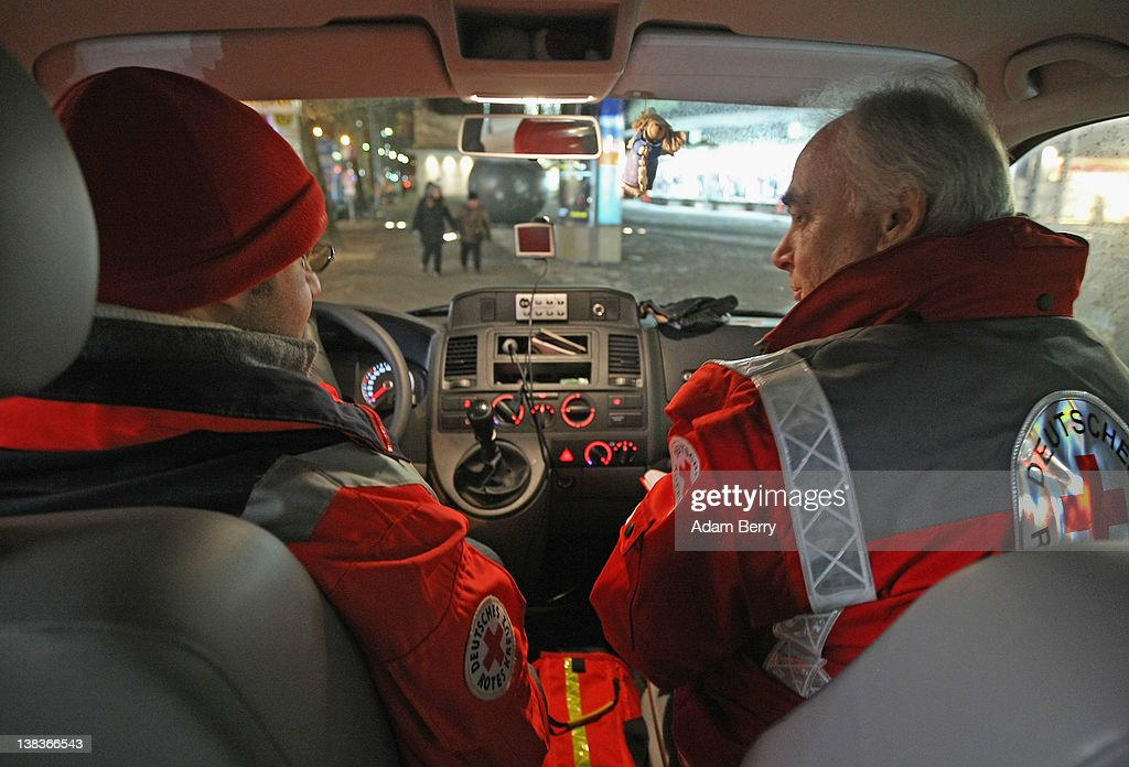 German Red Cross volunteers Adel Far (L) and Carlo Trobisch make the rounds in the Waermebus, or Warmth Van, on February 6, 2012 in Berlin, Germany. The Waermebus, a program ran by the German Red Cross, assists the homeless in times of extremely low temperatures with blankets, food, clothing and finding lodging. Nearly 300 people across Europe have died during the current cold wave, a majority of whom were without shelter.