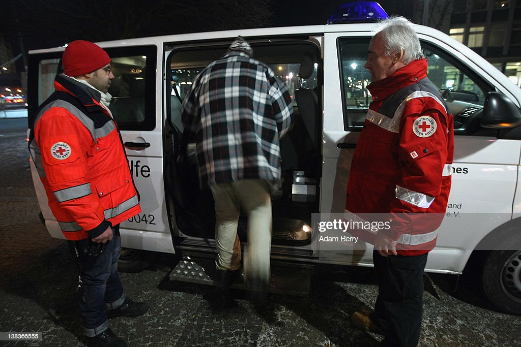 German Red Cross volunteers Adel Far (L) and Carlo Trobisch wait as a homeless man by the name of Rainer climbs into the Waermebus, or Warmth Van, to travel to a homeless shelter on February 6, 2012 in Berlin, Germany. The Waermebus, a program ran by the German Red Cross, assists the homeless in times of extremely low temperatures with blankets, food, clothing and finding lodging. Nearly 300 people across Europe have died during the current cold wave, a majority of whom were without shelter.