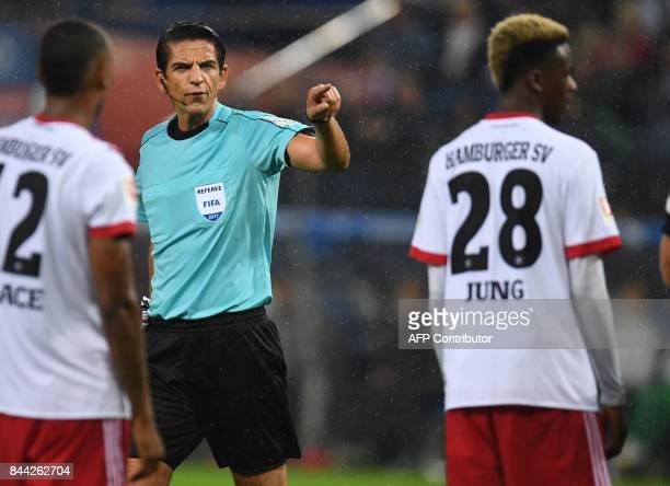 German referee Deniz Aytekin reacts reacts during German first division Bundesliga football match between Hamburger SV and RB Leipzig in Hamburg on...