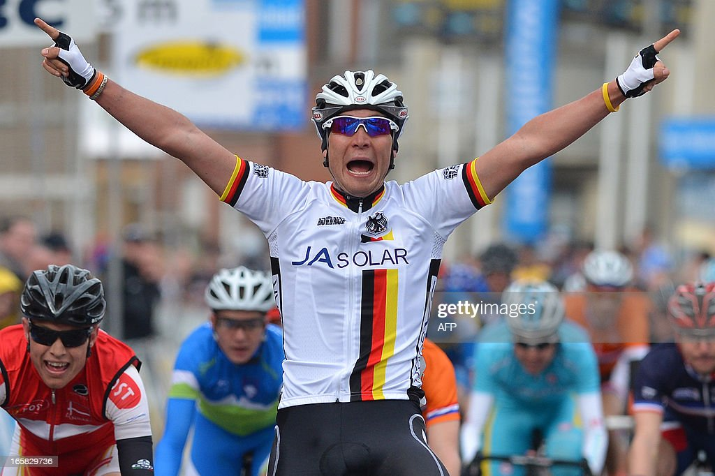 German Rick Zabel celebrates as he crosses the finish line during the 69th edition of the 'Ronde van Vlaanderen - Tour des Flandres - Tour of Flanders' one day cycling race for the U23, 160.6 km from Oudenaarde to Oudenaarde, on April 6, 2013.