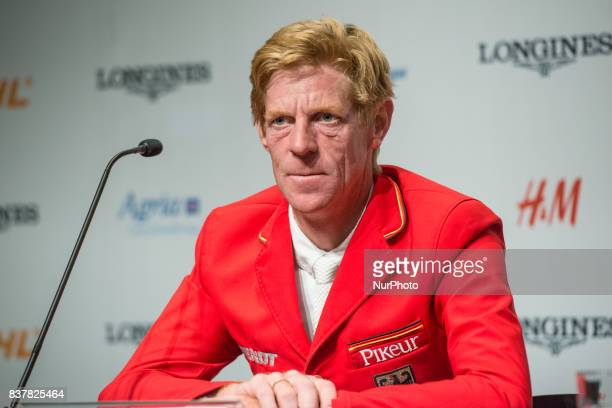 German rider and Olympic and World Cup Gold Medalist Marcus Ehning on Pret A Tout answers questions of the press after placing second in the...
