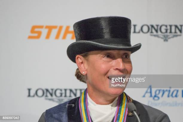 German rider Isabell Werth meets the press after winning the gold medal in the team dressage competition of the 2017 FEI European Championships in...