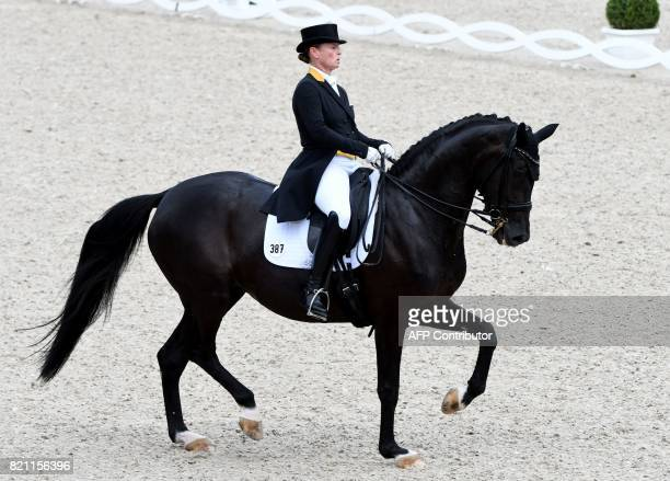 German rider Isabell Werth on her horse Weihegold OLD competes in the Grand Prix Freestyle CDIO during the World Equestrian Festival CHIO in Aachen...