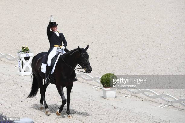German rider Isabell Werth on her horse Weihegold OLD waves after competing in the Grand Prix Freestyle CDIO during the World Equestrian Festival...