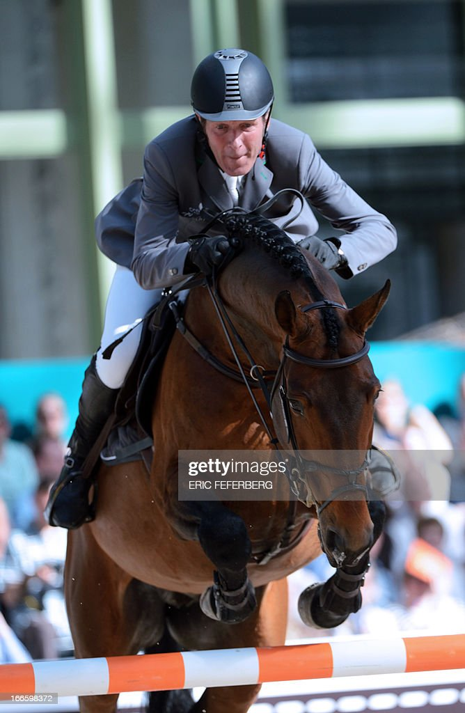 German rider Ludger Beerbaum on Chaman clears an obstacle on April 14, 2013 to win first place in the jumping event of the Grand Prix Hermes of Paris at the Grand Palais in Paris. AFP PHOTO / ERIC FEFERBERG.