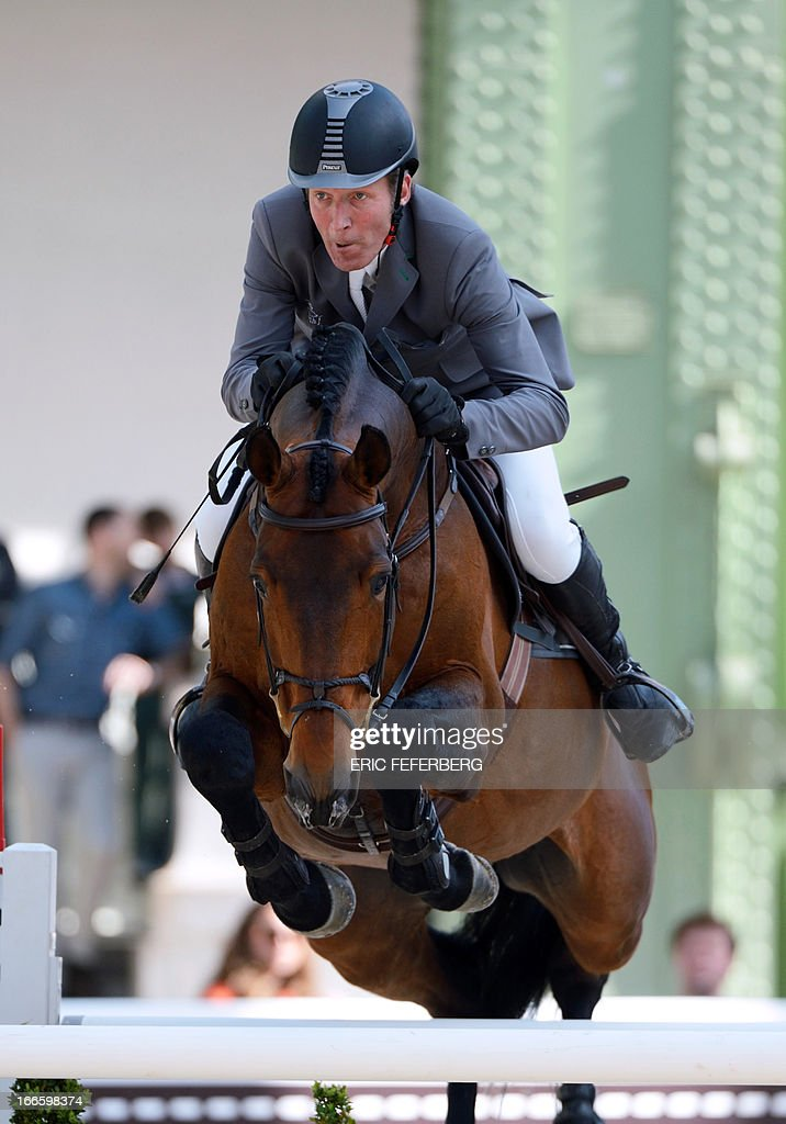German rider Ludger Beerbaum on Chaman clears an obstacle on April 14, 2013 to win first place in the jumping event of the Grand Prix Hermes of Paris at the Grand Palais in Paris.