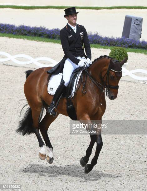 German rider Soenke Rothenberger on his horse Cosmo 59 competes in the Grand Prix Freestyle CDIO during the World Equestrian Festival CHIO in Aachen...