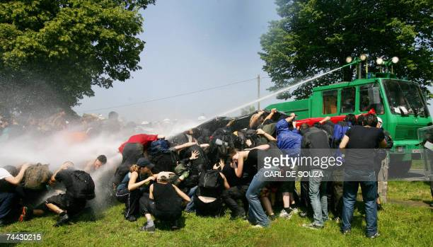 German riot police spray antiG8 protestors with water cannons at Hinter Bollhagen near Heiligendamm northeastern Germany 07 June 2007 as police made...