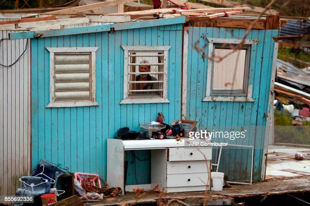 German Rodriguez looks through a window from inside his destroyed house in the aftermath of Hurricane Maria in Aibonito Puerto Rico September 29 2017...
