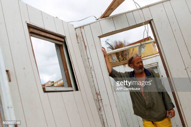 German Rodriguez surveys the inside his destroyed house in the aftermath of Hurricane Maria in Aibonito Puerto Rico September 29 2017 US military and...