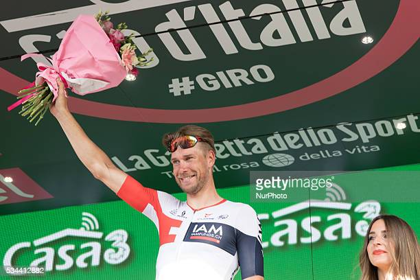German Roger Kluge of IAM Cycling celebrates on the podium after winning the seventeenth stage in the 99th edition of the Giro d'Italia cycling race...