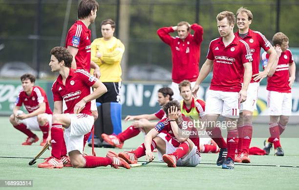 German RotWeiss Koln players react after losing the semi final from Belgian KHC Dragons at the Euro Hockey League match in Bloemendaal The...