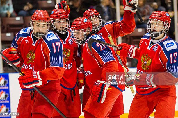German Rubtsov and Alexander Podkorytov of Russia celebrate a goal against the United States during the gold medal game at the World Under17 Hockey...