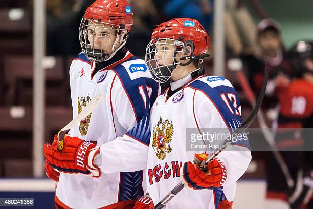 German Rubtsov and Nikita O Popugayev of Russia prepare for a shift against Canada Black during the World Under17 Hockey Challenge on November 2 2014...