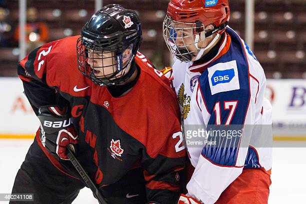 German Rubtsov of Russia battles for the puck against Brandon Saigeon of Canada Black during the World Under17 Hockey Challenge on November 2 2014 at...