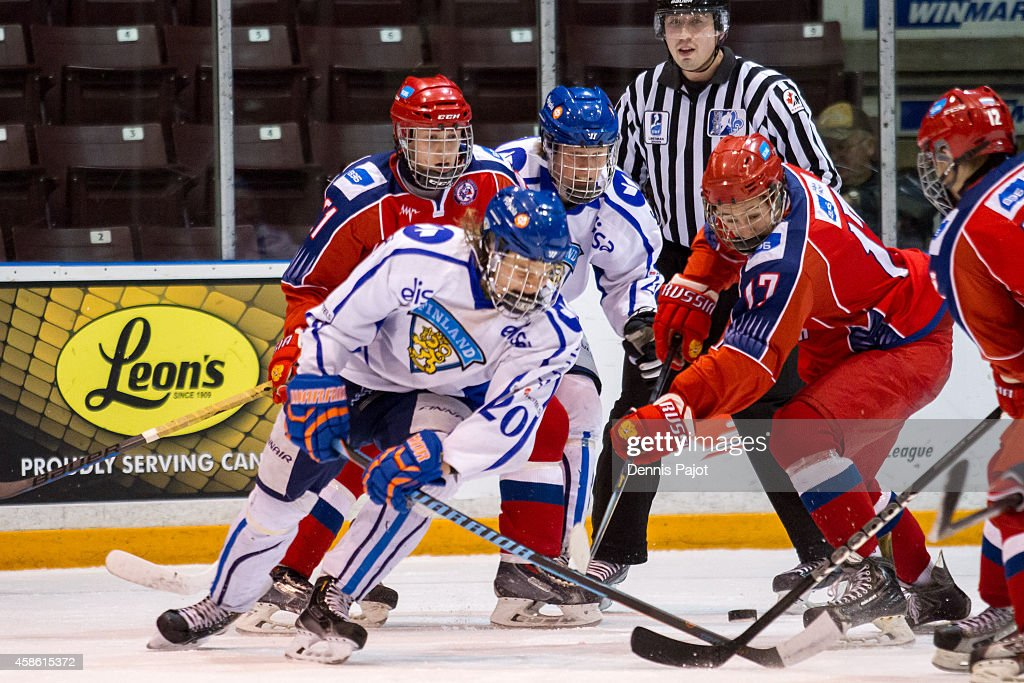 German Rubtsov #17 of Russia battles for the puck against Pete Niemi #20 of Finland during semifinals at the World Under-17 Hockey Challenge on November 7, 2014 at the RBC Centre in Sarnia, Ontario.
