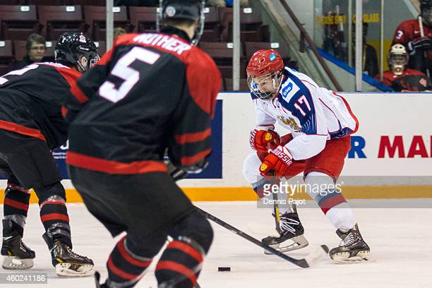 German Rubtsov of Russia moves the puck against Canada Black during the World Under17 Hockey Challenge on November 2 2014 at the RBC Centre in Sarnia...