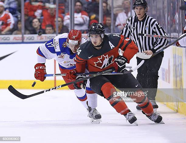German Rubtsov of Team Russia skates against Matt Barzal of Team Canada during a game at the the 2017 IIHF World Junior Hockey Championships at the...