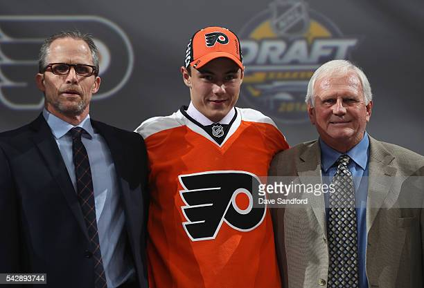 German Rubtsov poses with team personnel after being selected 22nd overall by the Philadelphia Flyers during round one of the 2016 NHL Draft at First...