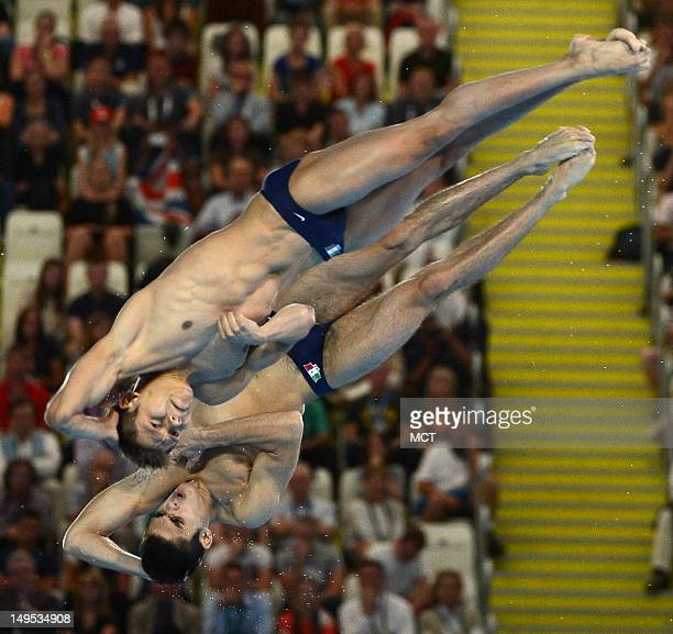 German Sanchez Sanchez and Ivan Garcia Narvarro of Mexico execute a forward 2 1/2 somersault and 3 twist dive in the sixth round of the Men's...