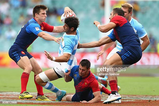 German Schulz of Argentina is tackled during the 2016 Sydney Sevens match between Argentina and France at Allianz Stadium on February 6 2016 in...