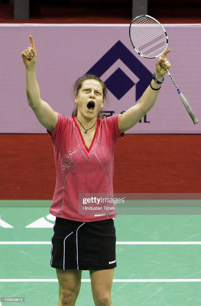 German shuttler <a gi-track='captionPersonalityLinkClicked' href=/galleries/search?phrase=Juliane+Schenk&family=editorial&specificpeople=653201 ng-click='$event.stopPropagation()'>Juliane Schenk</a> celebrates after her win against Chen Jia Xiao of China during the woMen's singles semifinal match of India Open Super Series 2012 at the Siri Fort Sports Complex on April 28, 2012 in New Delhi, India. Schenk won 21-16,21-13 and will now meet the second-seeded Chinese Li Xuerui in the finals.