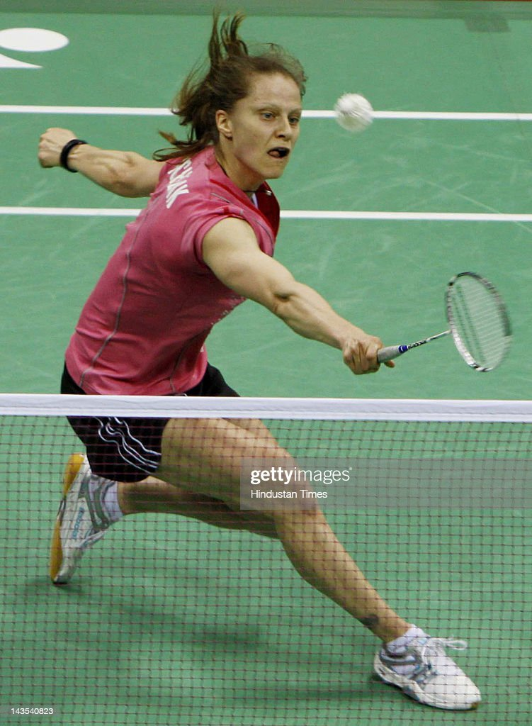 German shuttler <a gi-track='captionPersonalityLinkClicked' href=/galleries/search?phrase=Juliane+Schenk&family=editorial&specificpeople=653201 ng-click='$event.stopPropagation()'>Juliane Schenk</a> returns a shot against Chen Jia Xiao of China during the woMen's singles semifinal match of India Open Super Series 2012 at the Siri Fort Sports Complex on April 28, 2012 in New Delhi, India. Schenk won 21-16,21-13 and will now meet the second-seeded Chinese Li Xuerui in the finals.