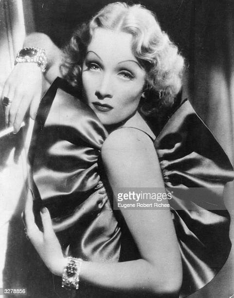 German singer and actress Marlene Dietrich in a typical arrogant but sexy pose from 'The Devil is a Woman' Costume design by Travis Banton