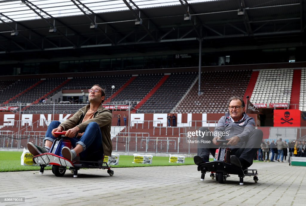 German singer ans songwriter Bosse and Ewald Lienen, technical director of St. Pauli in action during the viva con aqua social e-cart race at Millerntor Stadium on August 22, 2017 in Hamburg, Germany.