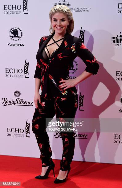 German singer Beatrice Egli arrives for the 2016 Echo Music Awards in Berlin on April 6 2017 / AFP PHOTO / Tobias SCHWARZ