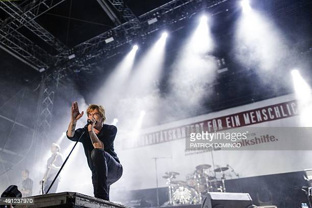 German singer Campino of 'Die Toten Hosen' performs at the 'Voices of Refugees' benefit festival organized to support refugees at the Heldenplatz in...