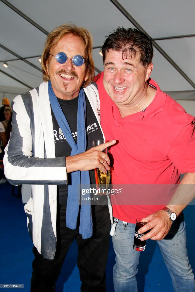 German singer Frank Zander with German sing Olaf Schenk of the duo 'Olaf und Hans' during the SchlagerOlymp Open Air Festival at Freizeit und Erholungspark Luebars on August 12, 2017 in Berlin, Germany.