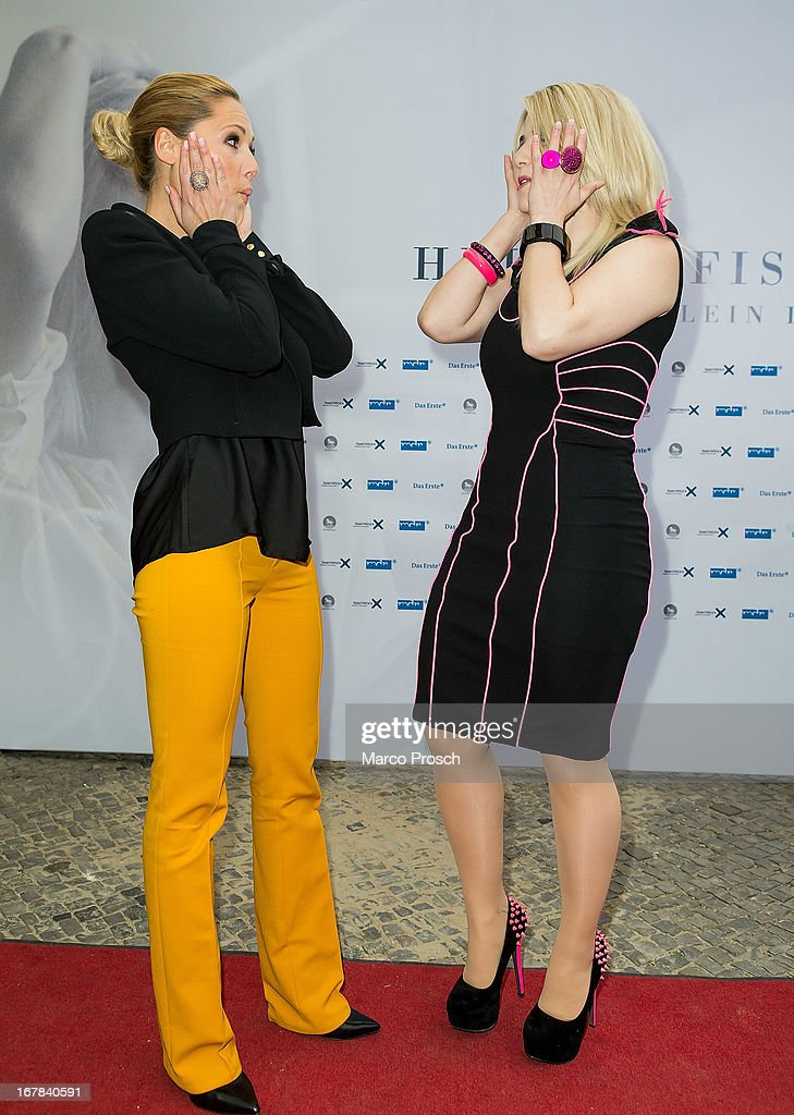 German singer Helene Fischer (L) and Swiss singer Beatrice Egli (R) attend the premiere of the documentary 'Allein im Licht' ('Alone in the light') at the Babylon cinema on April 30, 2013 in Berlin, Germany.