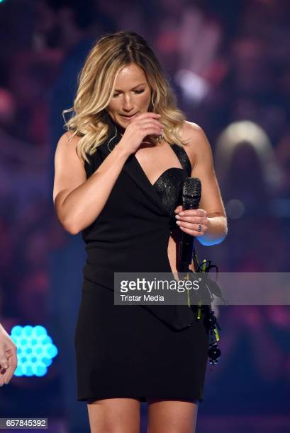 German singer Helene Fischer performs during the show 'Schlagercountdown Das grosse Premierenfest' at EWE Arena on March 25 2017 in Oldenburg Germany