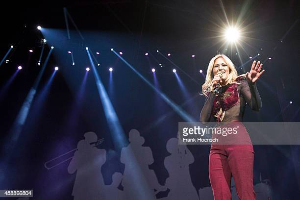 German singer Helene Fischer performs live during a concert at the O2 World on November 12 2014 in Berlin Germany