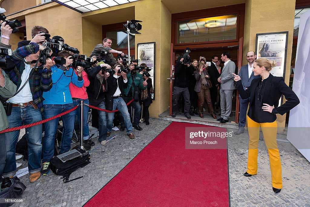 German singer <a gi-track='captionPersonalityLinkClicked' href=/galleries/search?phrase=Helene+Fischer&family=editorial&specificpeople=3628333 ng-click='$event.stopPropagation()'>Helene Fischer</a> poses for photographers prior to the premiere of the documentary 'Allein im Licht' ('Alone in the light') at the Babylon cinema on April 30, 2013 in Berlin, Germany.