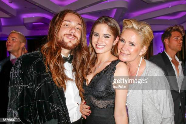 German singer Julian David with Claudia Effenberg and her daughter Lucia Strunz during the Kempinski Fashion Dinner on May 23 2017 in Munich Germany