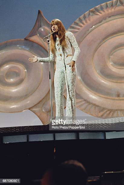 German singer Katja Ebstein performs the song 'Diese Welt' on stage for Germany in the 1971 Eurovision Song Contest at the Gaiety Theatre in Dublin...