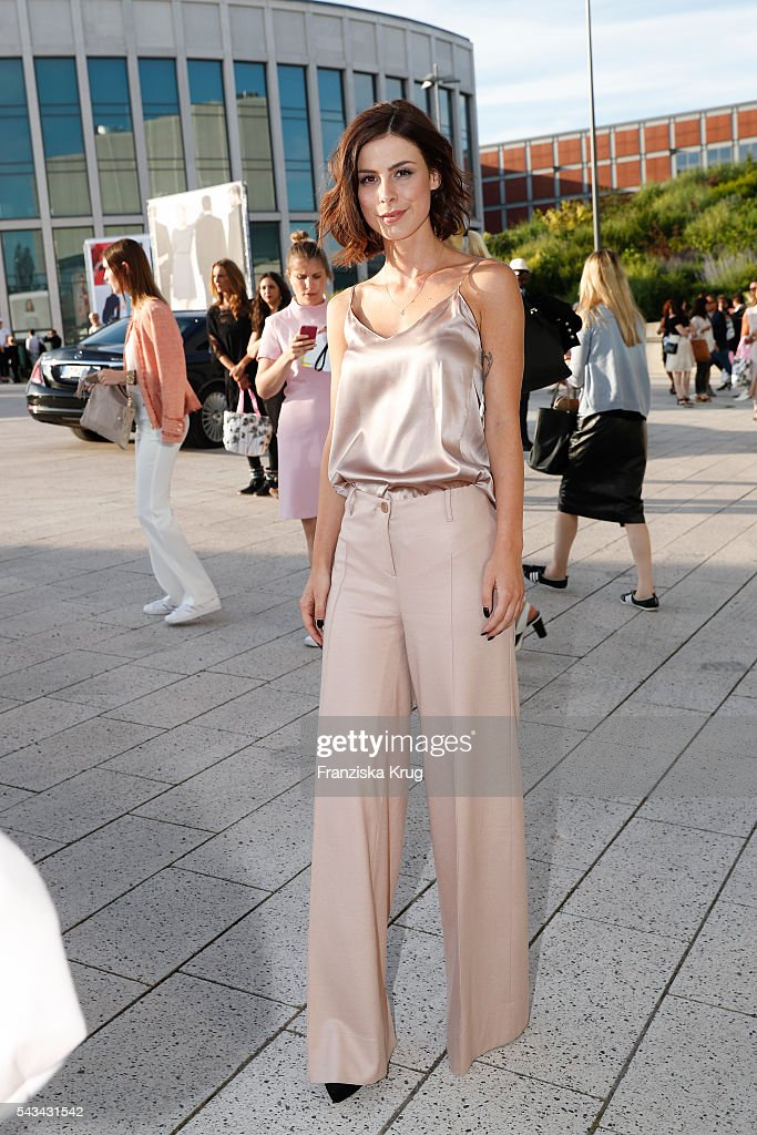 German singer <a gi-track='captionPersonalityLinkClicked' href=/galleries/search?phrase=Lena+Meyer-Landrut+-+German+Singer&family=editorial&specificpeople=6837968 ng-click='$event.stopPropagation()'>Lena Meyer-Landrut</a> attends the Marc Cain fashion show spring/summer 2017 at CITY CUBE Panorama Bar on June 28, 2016 in Berlin, Germany.