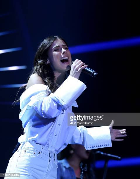 German singer Lena MeyerLandrut performs on stage during the Global Citizen Festival G20 benefit concert at the Barclaycard Arena in Hamburg northern...