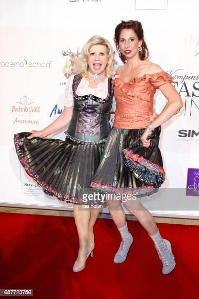 German singer Marianne Hartl and Dirndl Desinger Lola Paltinger attends the Kempinski Fashion Dinner on May 23 2017 in Munich Germany