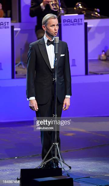 German singer Max Raabe performs live during a concert with his Palast Orchester at the Admiralspalast on October 22 2012 in Berlin Germany