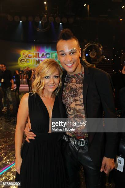German singer Michelle and german singer Prince Damien pose during the show 'Schlagercountdown Das grosse Premierenfest' at EWE Arena on March 25...