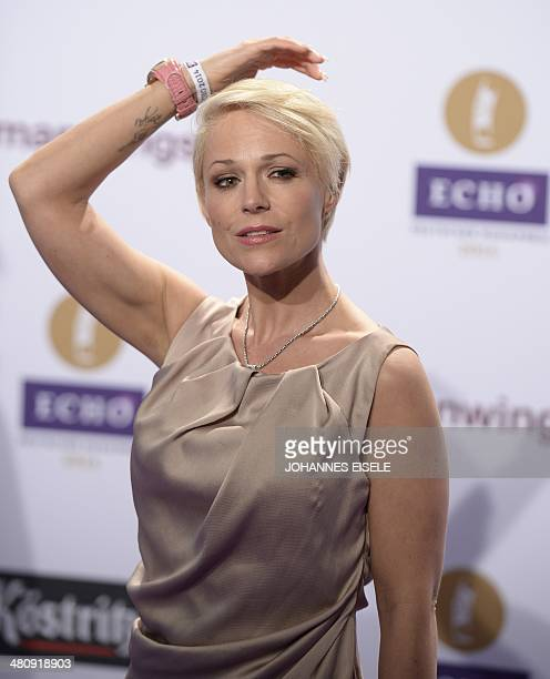 German singer Michelle poses on the red carpet as she arrives at the 2014 Echo Music Awards in Berlin on March 27 2014 The German music awards are...