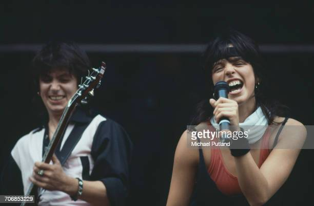 German singer Nena performing with guitarist Carlo Karges from her band of the same name at Werchterpark Werchter Belgium 10th June 1983