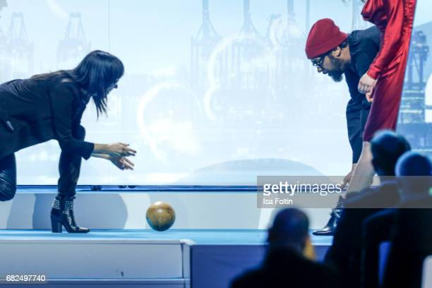 German singer Nena rolls the award to Rapper Samy Deluxe during the GreenTec Awards Show at ewerk on May 12 2017 in Berlin Germany
