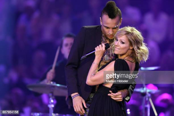 German singer Prince Damien and german singer Michelle perform during the show 'Schlagercountdown Das grosse Premierenfest' at EWE Arena on March 25...