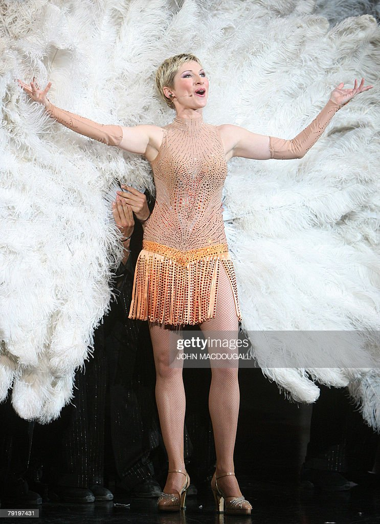 German singer Sabine Hettlich performs her routine during a press preview of the Friedrichstadtpalast music hall's latest show 'Glanzlichter der Revue' (Limelights of the Revue) in Berlin 24 January 2008. The show leading from the 1920s cabaret passing over Broadway shows to Parisian revue opens 25 January 2008 and runs until 29 June 2008.